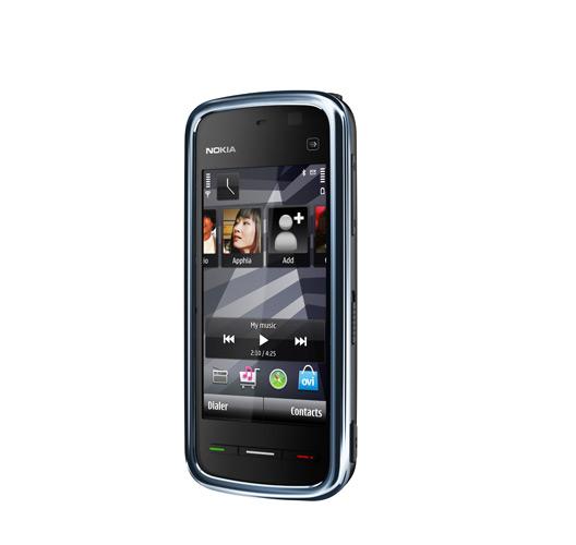 Аппаратной клавиатуры у Nokia 5235 нет. Для фотосъемки у смартфона